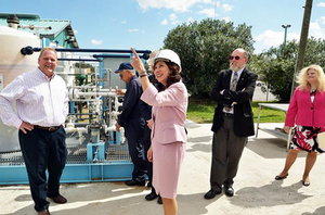 Labor Secretary Hilda Solis visits a factory to promote the department's new workforce development initiative.