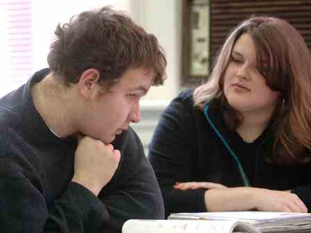An autism student receives tutoring.