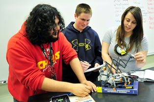 San Jacinto College math students, from left, Miguel Rosales, Harrison Mast and Darby Macha, participate in a robotics lab during Tech Friday.