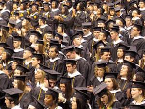 College graduates prepare to walk across the stage