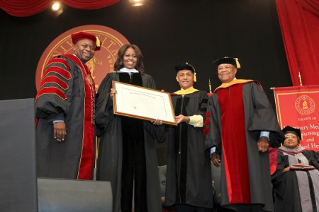 Dr. Brian L. Johnson, president of Tuskegee University (left), presents First Lady Michelle Obama with an honorary degree. (Photo courtesy of Tuskegee University)