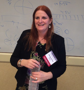 "Jacqueline Mogey, a math lecturer at the University of Auckland in Waipu, New Zealand, gives a presentation on ""fashionmatics"" at the 22nd International Conference of Adults Learning Mathematics in Alexandria, Va."