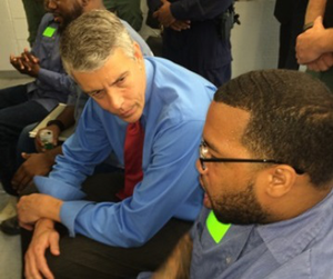 U.S. Secretary of Education Arne Duncan talks with an inmate at the Maryland Correctional Institution-Jessup about his participation in the Goucher Prison Education Partnership Program.