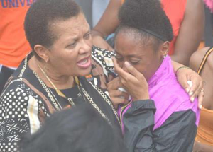 Dr. Cheryl Dozier, president of Savannah State University, comforts a grieving student.