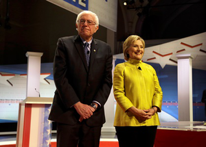 Democratic presidential candidates Sen. Bernie Sanders, left, and Hillary Clinton take the stage before a Democratic presidential primary debate at the University of Wisconsin-Milwaukee, Thursday, Feb. 11, 2016, in Milwaukee. (AP Photo/Tom Lynn)