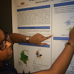 "Jasmine Jackson, a second-year Ph.D. student of applied mathematics at Arizona State University, shows her poster that details the threat of the deadly ""kissing bugs,"" which have been spotted in certain parts of the United States."