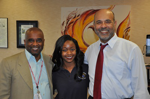 Jalia Johnson is flanked by UDC President Mason and COO Troy Stoval. Jalia was the first DC student to accept a DC-UP scholarship.
