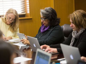 Female professors at Texas Tech University work on their research during their weekly meeting with the Women's Faculty Writing Program. (Photo courtesy of Texas Tech University)