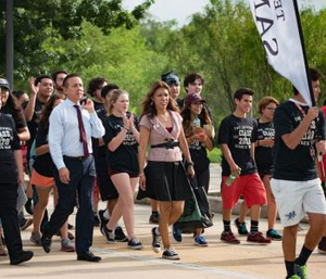 Dr. Cynthia Teniente-Matson, president of Texas A&M University-San Antonio, leads the Jaguar March on campus, celebrating the start of the year for the university's first roster of freshmen.