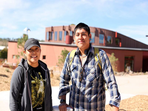 Students stand in front of NAU's Native American Cultural Center, home to more than 1,500 students from 127 tribes. (Photo courtesy of Northern Arizona University)