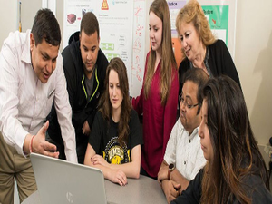 Professor Anupam Joshi, left, collaborates with his students at the University of Maryland, Baltimore County.