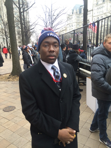 "Diante S. Johnson, a student at the University of Illinois, says President Trump is ""gonna do a great job."" ""He cares deeply for this country and he's gonna do a great job,"" Johnson, 20, a University of Illinois at Champaign student and founder of the Black Conservative Foundation"