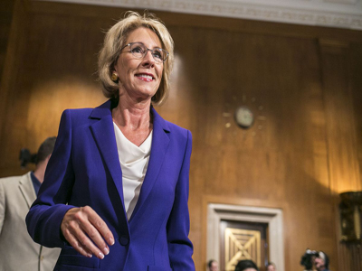A 12-11 vote, split strictly along party lines, sends Betsy DeVos' confirmation process as education secretary to the full Senate.