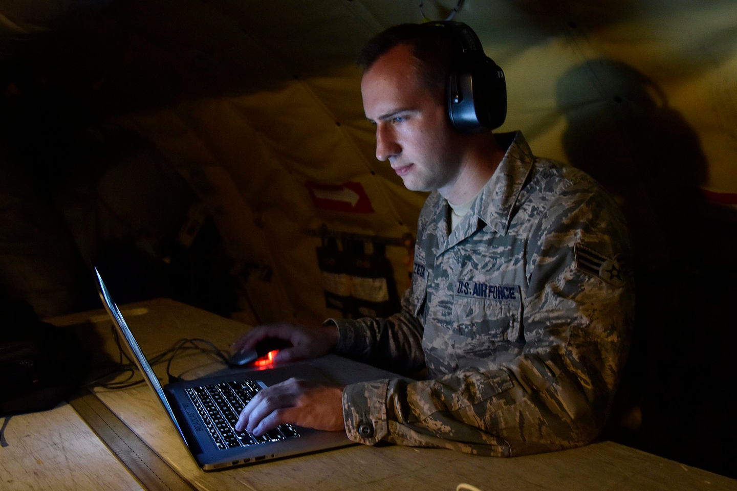 Senior Airman Ryan Zeski uses time during a long flight to work on some homework for a course he is taking at Oakland University.